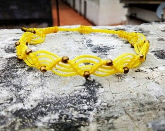 Yellow macrame bracelet in the wave design