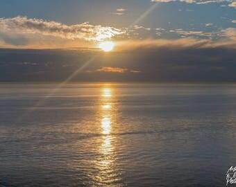 Sun Streaking On The Ocean Print