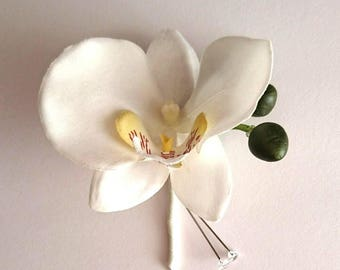 White phaleanopsis orchid buttonhole or boutinerre for groom or groomsmen.