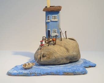 Blue Cottage on Sea Sculpted Driftwood.