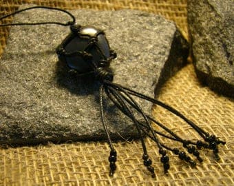 Shungite pendant polished tied with cord from Karelia.