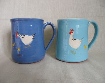 Handmade pottery chicken with chicks mug in dark blue or turquoise with white inside. Two sizes