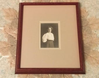 Vintage Photo of Young Woman in White Blouse and Dark Skirt