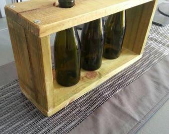 Table centerpeice, triple vase, prosecco bottles.