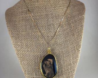 Black and beige pendant
