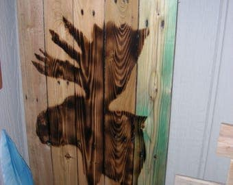 A torched Moose Head  on reclaimed wood that is clear (Polyester) coated
