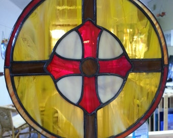 Tiffany stained glass Celtic weapons shield in colorful glass as window hanger, suncatcher, window decoration, historic image in glass