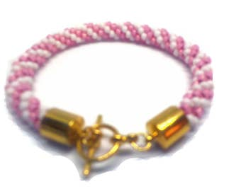 Feminine pink and white beaded bracelet woven on a Kumihimo braid