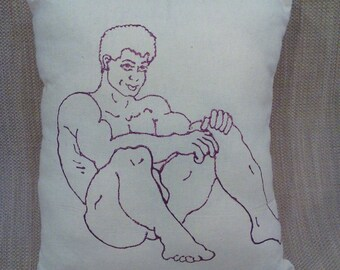 Male figure painted in glittered purple on cotton pillow