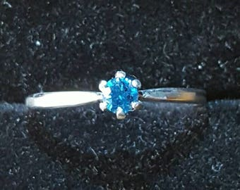 3.5mm blue diamond and silver solitaire ring.