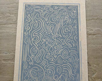 Swirls and circles linocut in textured grey ink on recycled paper, greetings card.