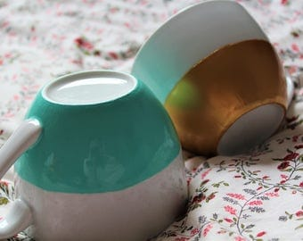 Gold and turquoise cappuccino cups decorated by hand