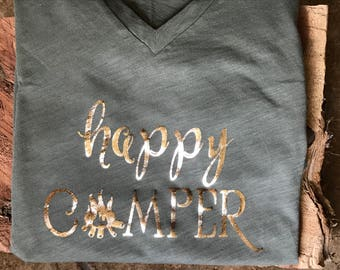 Happy Camper iron on foil decal  with camper on the back of shirt in lower right-hand corner