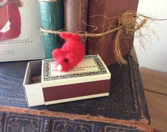 Small red mouse needle felted using pure wool , living in his own little mouse box.