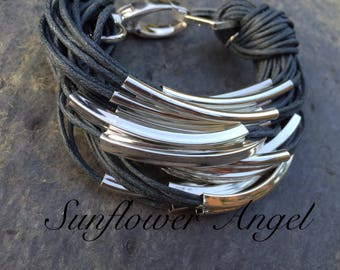 Multi stranded grey twine bracelet, with silver bars and large lobster clasp.