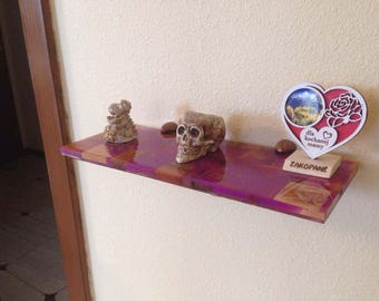 Glow-in-the-dark shelf made from pieces of a pink pear wood&clear epoxy