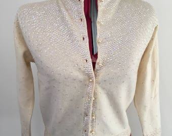 Vintage cream cashmere hand beaded cardigan.