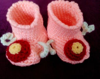 Self-crocheted baby booties in pink