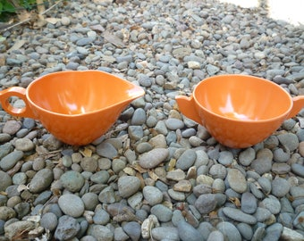 1960s melamine tangerine creamer and sugar bowl
