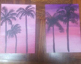 Handmade custom silhouette of palm trees in a radiant sunset