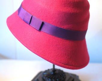 Cloche hat, fuchsia felt with purple ribbon