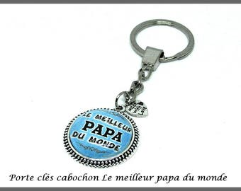Fancy man keyring in silver plated metal with glass cabochon The World's Best Dad blue blue
