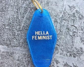 Hella Feminist Hotel Key in Translucent Blue Feminism Key Chain by Minor Thread Motel Key Fob