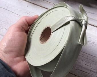 Vintage light green bias ribbon roll,New old stock,Seventies ribbon bias tape,Roll of ribbon,Border tape,Shiny roll of green ribbon