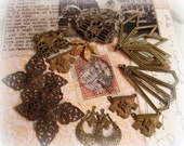 assorted vintage brass filigree connectors and dRops varying natural patinas on raw brass one ring and two ring findings circa 1940s - 1970s