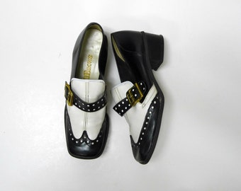 Hibrows . 60s black and white faux leather monk shoes .  size 7.5