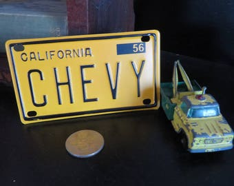 Metal California Bicycle License plate novelty 1956 Chevy Yellow and Black