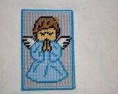 Boy angel note holder