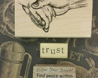 lot of 7 rubber stamps. art journal supplies. wood mounted. create tags. cards. phrases. sayings. words. hands. trust. dreams. family