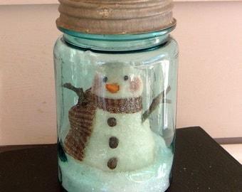 Primitive snowman snow globe blue pint mason jar
