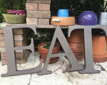 VINTAGE DECOR...15 inch E A T~ taupe heavy aluminum ~ industrial metal ~ sign ~ wall decor ~ steampunk ~ kitchen lounge ~rare find