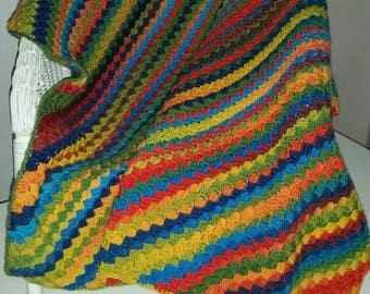 Rainbow coloured crochet baby blanket in wool blend