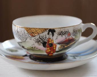 Beautiful vintage Japanese porcelain cup and saucer