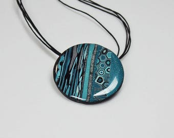 Polymer clay pendant, abstract, turquoise and black