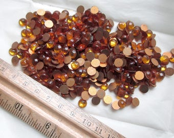432 pcs. 3 gross vintage glass topaz foiled flat back 7mm cabochons in original package from Western Germany