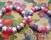 Two pink white and purple star bead bracelets kawaii kandi rave