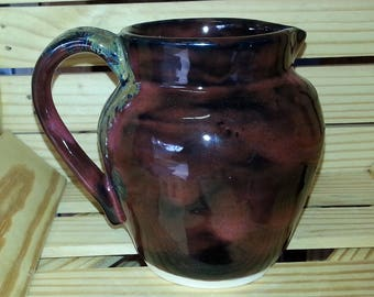 red-black pitcher or utensil holder