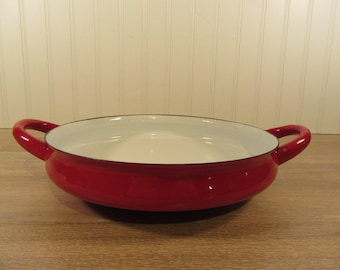 Red enamel Dansk open ware cook pan with side handles- white interior, paella pan