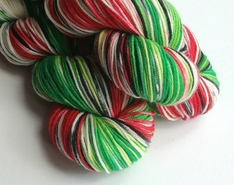 Hand dyed wool yarn, Betelgeuse, 100g of superwash merino dk wool yarn - Crazy 8. Reds, black. green, white. Double knit yarn. Astronomical