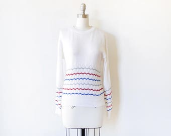 vintage white 80s sweater, white pointelle sweater with red, blue, and gray chevron stripes, pullover knit top, medium m