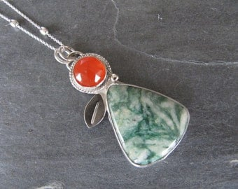 Pendant of Mariposite, Carnelian, and leaf in Sterling Silver