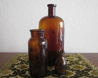 Three vintage Amber Apothecary glass bottles