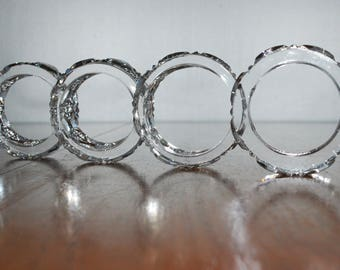 four cut crystal napkin rings  -  formal dining