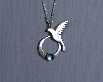 Sacred Bird handmade silver necklace with blue topaz