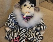 Reserved for Christina Gonzalez.  Sock Monkey Polly Esther, Queen of the trailer park.  Made by hand in the USA.