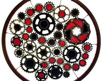 Stained glass bicycle wheel called Black Hole Sun - recycled bicycle art